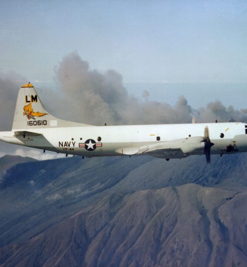 Aerial right side view of a P-3C Orion (ASW) antisubmarine aircraft of Patrol Squadron Forty-Four (VP-44), the Golden Pelicans.  The squadron home based at Naval Air Station Brunswick, Maine is presently forward deployed to NAS Signonella.