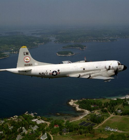 Aerial right rear view of a P-3C Orion antisubmarine warfare (ASW) aircraft from Patrol Squadron Forty -Four (VP-44) in flight over the New England country side.  VP-44 was officially disestablished on 31 May 1991.